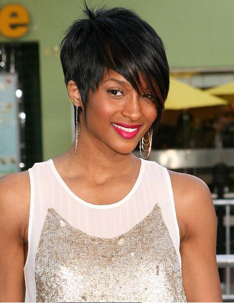 The hair is middle parted. Lob Hairstyle With Bangs Curly and super-sleek,